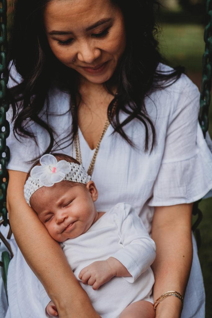 Best Maternity and Newborn Photographer Washington DC Maryland Virginia mother and newborn wearing white sitting in swing