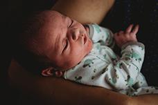 best Newborn Maternity Photographer Washington DC Maryland Northern Virginia newborn photography session washington dc newborn asleep in mother's arms