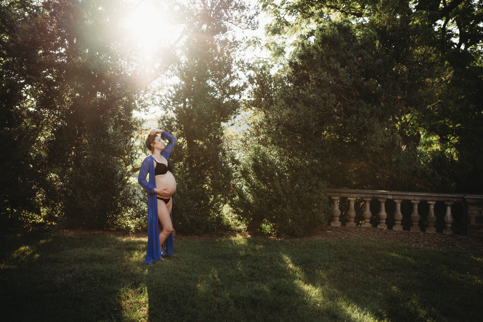 Best Maternity and Newborn Photographer Washington DC Virginia Maryland casual lifestyle in home maternity photography session pregnant woman lying on bed in black underwear in front of bright windows
